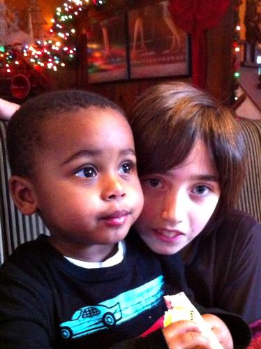 Kai loves his baby cousin